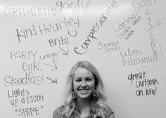 Use a whiteboard as a backdrop for a photo. Positive things about that person written all around!
