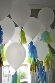 white balloons with neon green and blue fringe mossandmint.com