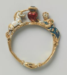 Gold enameled ring set with diamonds. In the center is a heart topped by a diamond between a white unicorn and a woman dressed in blue. Made in either Southern Germany or Italy, circa 1550-1600