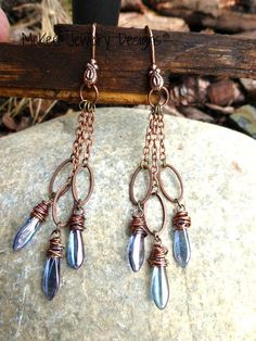 Purple Picasso Czech glass daggers and Long copper earrings. McKee Jewelry Designs