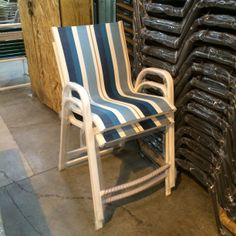 Seabreeze stacking balcony chairs shown with a River White frame finish and C161 Pompadour Stripe sling fabric.
