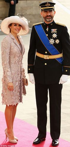 LOVE the hat!    Crown Prince Felipe of Spain and Princess Letizia of Spain attending the wedding ceremony