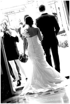 Bridal style bride trend. Ivory satin fishtail wedding dress. Single shoulder strap detail, rouched detail on shoulder strap. Groom style trend black slim fit suit. Bright day wedding day, bride and groom arrive for their guests. Malta wedding. Summer Maltese wedding day. Candid artistic wedding photography. Creative photographer