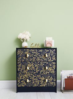 Add a pretty pattern to an IKEA dresser by cutting wallpaper to size (leftover pieces and sample swatches work great!) and attaching with wallpaper glue. Paint the frame a subtle high-gloss shade, then screw on chic pulls.