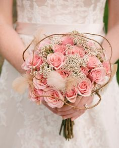Stunning pink bouquet with feather accents! From Violet Bride blog.  Wilton Photography Cherry Blossom
