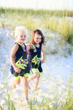 Arm in arm. <3<3 Two best friends in their #zoologykids fish dresses running along the shoreline at dusk.