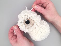 DIY Pom Pom Puppy Pal [Rainy Road note: Options: Consider safety by sewing the smaller poms to the body. Make toy larger! Pom Pom Puppies, Pom Dog, Pom Pom Crafts, Yarn Crafts, Fabric Crafts, Craft Stick Crafts, Crafts To Make, Puppy Crafts, Pom Pom Animals