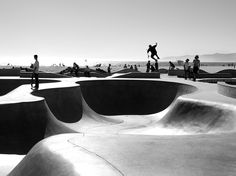 Skateboarders fly through the air at Venice Beach, California, in this National Geographic Photo of the Day.