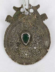 Silver pendant from Essaouria, Morocco. This is called a citadel piece, worn at the forehead. Double ram's head on rear. Private collection of Savanna Caravan.