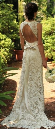Get inspired: A beautiful cutout-back lace wedding gown with a little bow. Perfect for an intimate springtime garden ceremony!