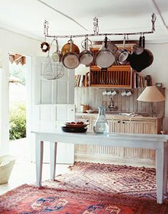 =) love the way this leads outside ceiling a bit low but love the rug, white, pan rack too
