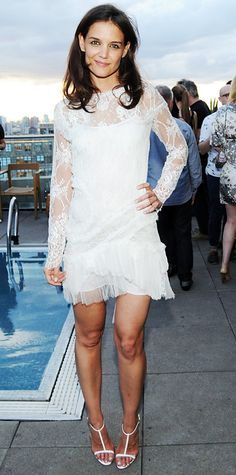 Katie Holmes made a sweet statement at the ASP's World Surf League party in a lace Nina Ricci LWD and white T-strap sandals.