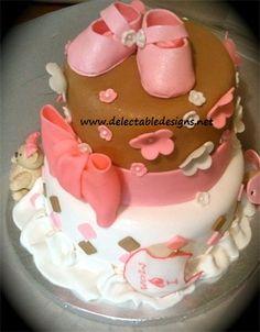 Girl Baby Shower Cake- cute baby girl baby shower cake with gumpaste booties.