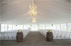 We love how this couple kept their wedding ceremony decor simple so that all eyes would be on them for their special day. Photo Credit - Tiffany Wayne Photography