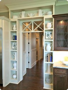 This doorway with built-ins is beautiful! http://www.oldtimepottery.com/