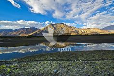 Royalty free stock photo, image | REFLECTION IN NUBRA VALLEY - reflection, Nubra Valley, Leh, LADAKH., mountains, trekking, mountain pass, places to visit, terrain, rocky, chilly, cold, places of interest, photography, scenic, high altitude, Buddhism, India