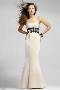 Matte satin a-line bridesmaids gown with pleated bust. This gown also features lace below the bust.