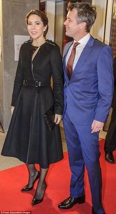 Elegant duo: Mary looked sensational in a blazer style black dress while Frederik wore a deep blue suit with a maroon tie
