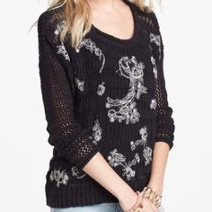"""NWT Free People Knit Sweater New with tags. Oversized styling. Lightweight black embroidered sweater. So pretty!  White floral pattern woven throughout front of sweater. Light and airy!  Size XS, but is oversized and would easily fit a Small also. Cotton/Acrylic knit. Measures:  24"""" armpit to armpit and 19"""" long.  No trades. Free People Sweaters"""