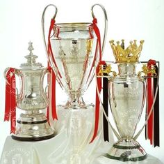 Manchester United : FA Cup, Champions League trophy and Premiership trophy.