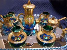 Vintage Cobalt Blue Venetian Art Glass Tea Set  This stunning set is lavishly decorated with hand-painted gold trim and enameled floral embellishments. The blue glass is clear and vibrant. The se...