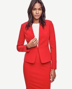 """Impeccably seamed to fit and flatter, this sleek crepe piece features a single hook-and-bar closure for a refined finish. Long sleeves. Front hook-and-eye closure. Lined. 22"""" long."""