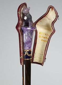 1900-1910 Parasol Pug knob by Betaille.  This parasol is an example of French artistry as well as an expression of the decorative aspects of the parasol. A custom-made piece, the parasol undoubtedly belonged to a pug owner, given the expensive amethyst pug knob with customized cover. Walking Sticks And Canes, Wooden Walking Sticks, Cannes, Stone Carving, Wood Carving, Cool Canes, Art Nouveau, Raising Canes, Walking Staff