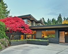 nice drive way design, nice tiled planters and front door.