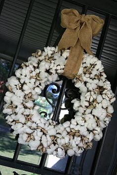 Southern charm!  Cotton & burlap wreath.  Living in the deep south (God's country!) the materials should not be hard to come up with!!!