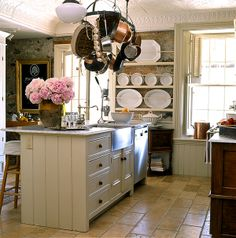Country kitchen with pot rack and thumbed marble floor/plate rack with ironstone polatters tile | Styled and design by Susan Burns