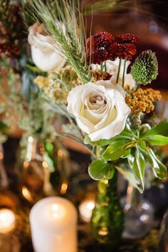 White rose centerpiece | Ashley Gerrity Photography | see more on: http://burnettsboards.com/2014/10/gothic-wedding-ideas/