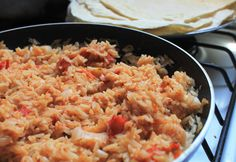 Mexican rice is a traditional rice dish that is very easy to prepare. In this vegetarian and vegan recipe, the rice is toasted with spices then simmered with tomatoes. Vegetarian Mexican Recipes, Vegetarian Burrito, Vegan Recipes, Vegan Meals, Easy Recipes, On The Border Rice Recipe, Homemade Vegetable Broth, Homemade Refried Beans, Rice Recipes For Dinner