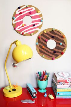 Cardboard donuts? There's no instructions on the link, but I think the kids would have a blast making giant donuts with cardboard, paper, paint, and pompoms.