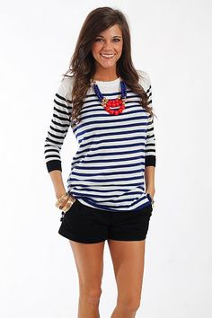 """How cute is this top?! The lightweight sweater material is perfect for spring, and we love the blue stripes on the body combined with the black stripes on the sleeves. Plus, did you see the exposed black zipper on the back? We love that detail!   Fits true to size. Miranda is wearing a small.   From shoulder to hem:  Small - 26.5""""  Medium - 27.5""""  Large - 28.5"""""""