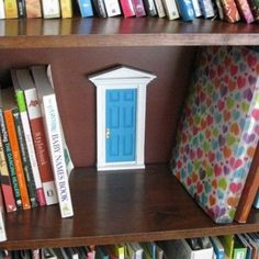 """Cute little """"door"""" behind books. could have a code in the door to get into the secret private room"""