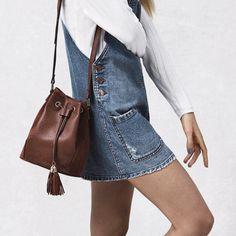 denim dress, white shirt, chocolate brown bucket bag