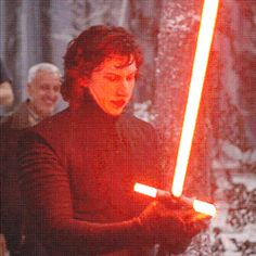 Adam Driver testing out Kylo's lightsaber