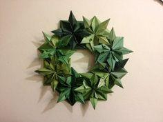 Wreath 25 Days of Origami Day 17 Origami Day, Origami Wreath, Origami And Quilling, Origami And Kirigami, Origami Stars, Origami Flowers, Paper Folding Crafts, Paper Crafts Origami, Christmas Origami