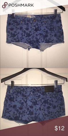 Cutoff shorts with flower pattern Cutoff shorts with flower pattern size 3. Gently used, in great condition! Cheaper through MERC! Volcom Shorts Jean Shorts