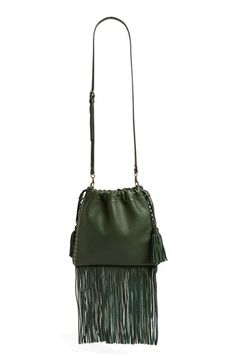 Free shipping and returns on Rebecca Minkoff 'Moto' Fringe Drawstring Crossbody Bag at Nordstrom.com. Long tonal fringe and high-shine grommets detail this edgy-but-elegant crossbody bag by Rebecca Minkoff. A drawstring closure and lightly slouchy silhouette in lavishly textured leather further the attitude, while an optional crossbody strap adds styling versatility.