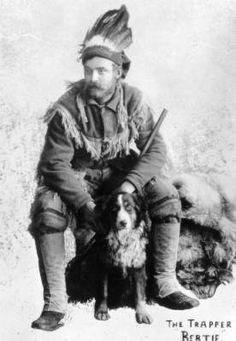 Bert Gross, Trapper, with a dog and animal skins, Crested Butte, Gunnison County, Colorado, 1890