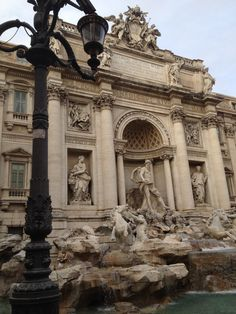 Trevi Fountain. First coin for a wish, second coin to ensure you return to Italy.  I hope it works!