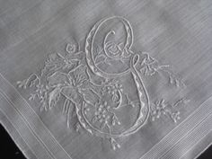 Embroidered initial on antique linen hankie