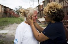 "Genice Gipson comforts her lifelong friend, Loretta Capistran, outside of Capistran's apartment complex in Refugio, Texas, on Monday, Aug. 28, 2017. ""We got to be strong, baby,"" Gipson told Capistran. (Nick Wagner/Austin American-Statesman via AP)(Nick Wagner/AP)"