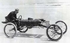 Ransom E. Olds (Oldsmobile) in the Olds Pirate racing car in 1896 or 1897, minimalist engineering for the greatest safety risk, how times have changed.