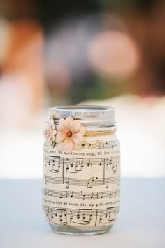 Sheet music on mason jars. Light a candle inside at night, and the music glows! Totally going to try this with my old sheet music.