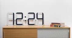Electronic Paper Clockone by Twelve24Clocks is 1 meter wide by 4 millimeters thick and runs for one year on one battery.