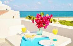 El Corales Suites, situado a sólo 200 metros de la playa de Puerto Morelos, dispone de una terraza en la azotea y suites balcón, terraza... #Cancun #Mexico #Hoteles