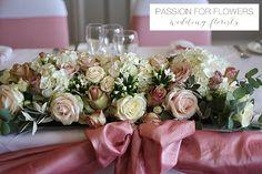 Pastel pink top table wedding flowers