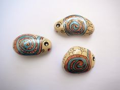 Snail fish family - inspired hand painted stones.